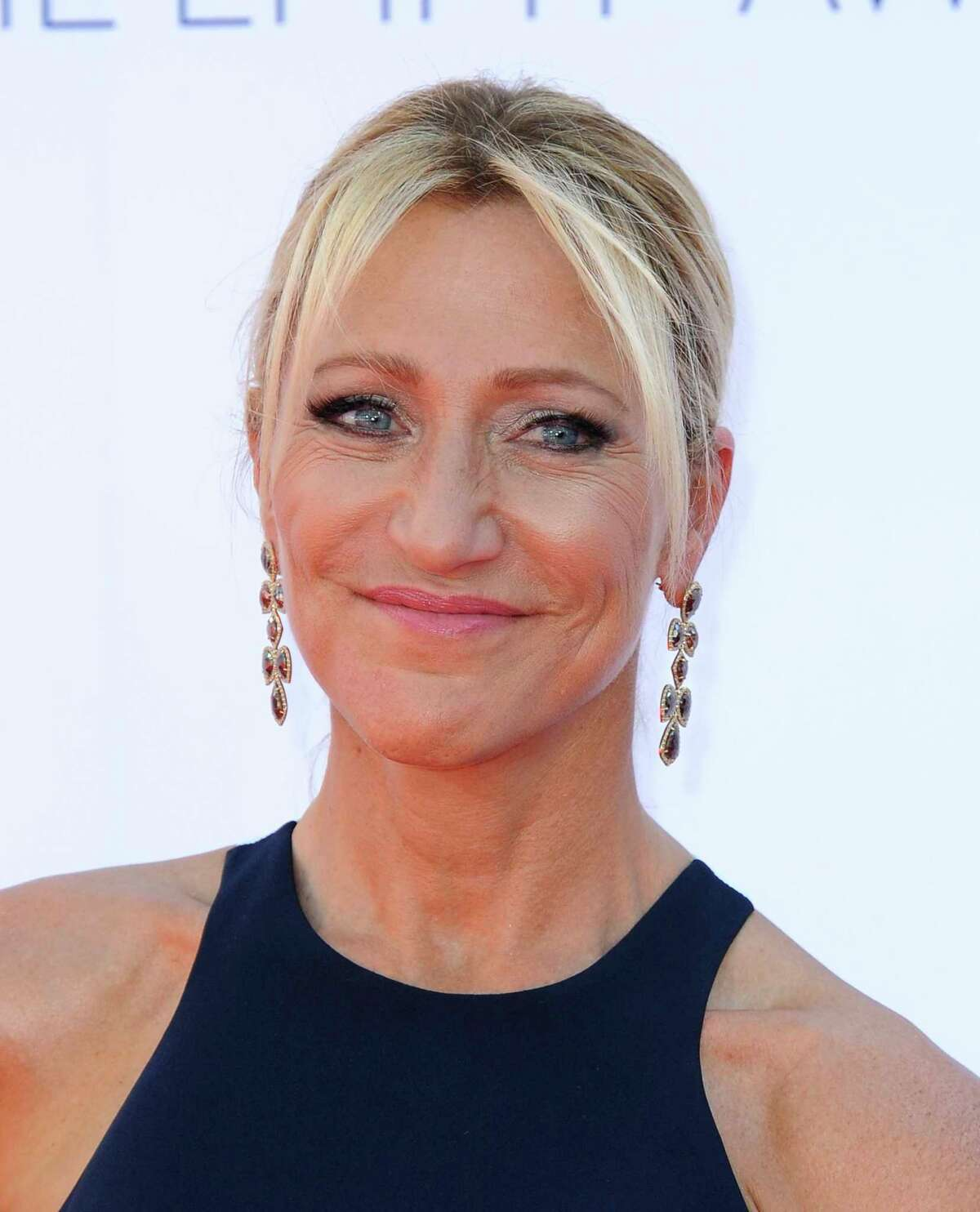 Actress Edie Falco arrives at the 64th Primetime Emmy Awards at the Nokia Theatre on Sunday, Sept. 23, 2012, in Los Angeles. (Photo by Jordan Strauss/Invision/AP)