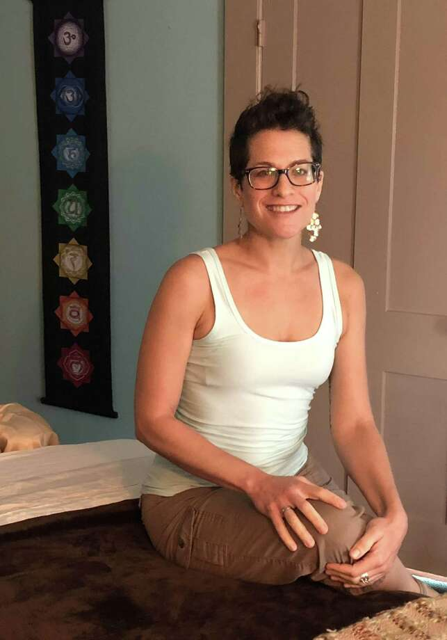 Lisa Lent, a licensed massage therapist, has opened The HeartSpace Studio for the Healing Arts in New Milford, where she offers intuitive massage. Photo: Deborah Rose / Hearst Connecticut Media / The News-Times  / Spectrum