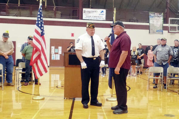 As part of dedication of the Cass City VFW's Vietnam Memorial, there was a pinning ceremony. Right, former U.S. Marine William (Bill) Mielke, of Sebewaing, was among those who received a pin and explained to Tuscola County Veteran Affairs Director Mark Zmierski, left, his branch of service and time served.