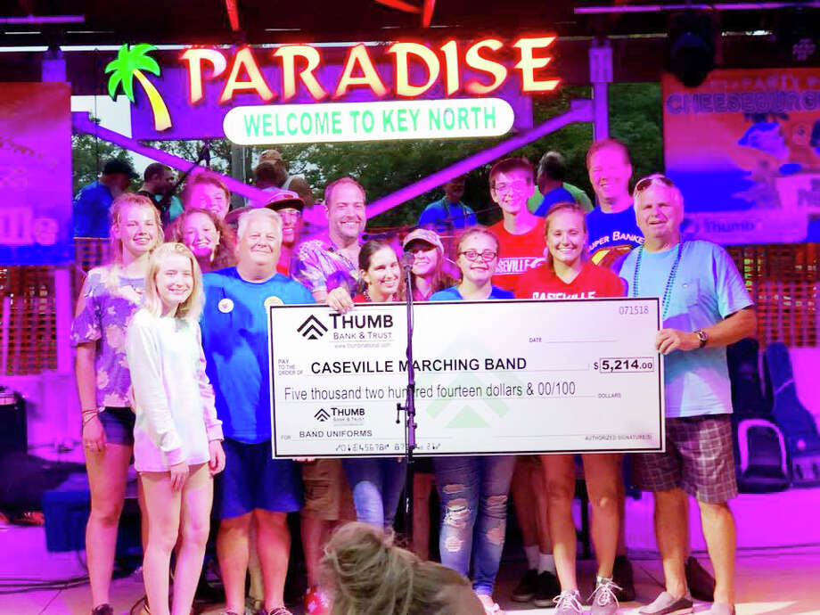 Thumb Bank & Trust recently presented a check for more than $5,000 to the Caseville High School Marching Band for new uniforms. All of the money was raised from the bank's Key North Classic golf tournament. Photo: Submitted Photo