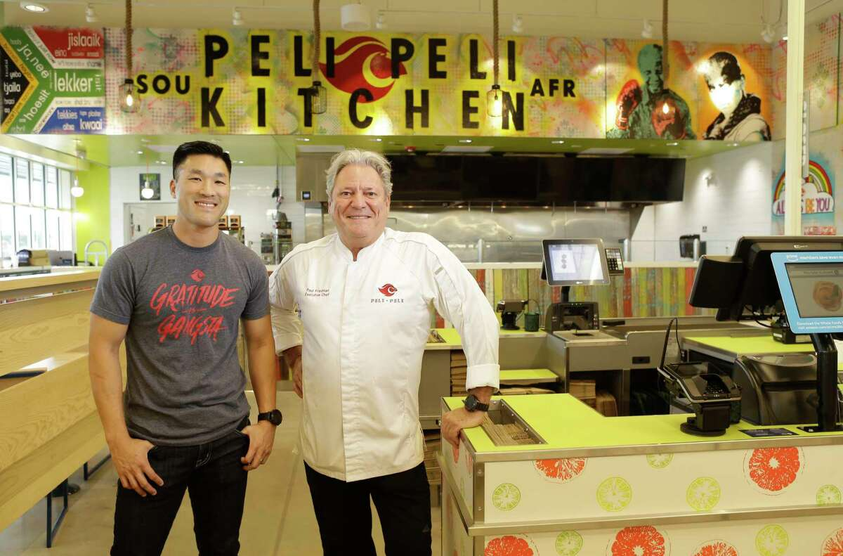 Thomas Nguyen, partner and marketing director, and Paul Friedman, executive chef/partner, at Peli Peli Kitchen located inside the new Whole Foods Market 365, 101 North Loop West.