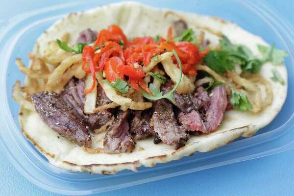 1of 9a south african fajita taco at peli peli kitchen inside the new whole foods market 365 101 north loop west opening aug 22 - Peli Peli Kitchen