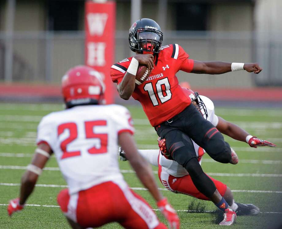 Westfield quarterback Terrance Gipson looks for a hole between North Shore's Drevian Williams-Nelson (25) and Jordan Revels in the first half of their game at George Stadium in Spring, Sept. 15, 2017. Photo: Michael Wyke, Freelance / For The Chronicle / © 2017 Houston Chronicle