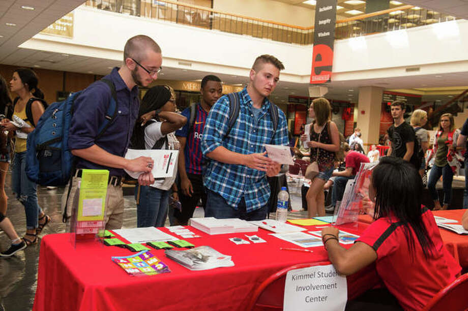 Nathan Cauley (left), of Bunker Hill, and Logan Siekmann, of Troy, visit with a representative from the Kimmel Student Involvement Center during the SIUE Resource Fair. Photo:       For The Telegraph