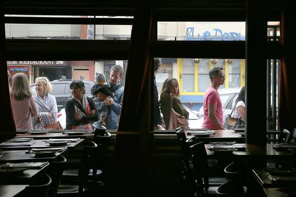 A line waits outside of Burma Superstar before it opens for dinner in San Francisco, California, on Friday, May 1, 2015.