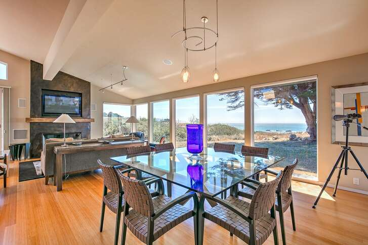 Oversized windows frame views of the Pacific Ocean at 40481 Tide Pool in Sea Ranch.