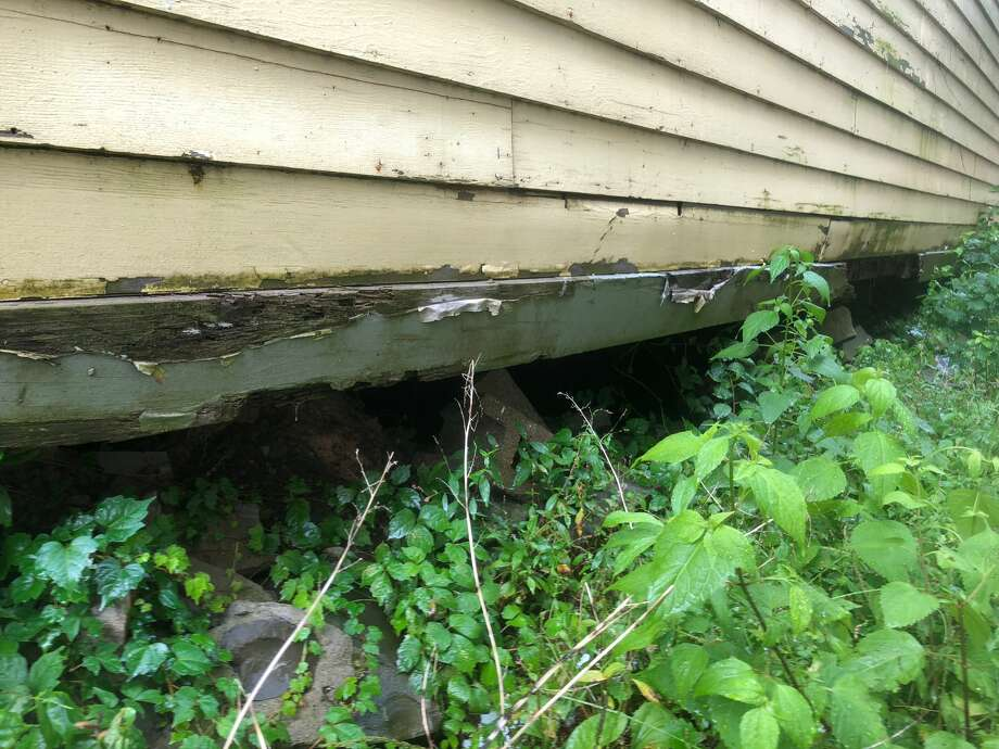 Cosimino Marruso has filed a notice of claim against the city of Schenectady, alleging that a long-neglected and now-city-owned home at 122 N. Ferry St., is at risk of collapsing on his home next door. IN this photograph, the foundation appears to have collapsed under part of the structure at 122 N. Ferry St. Photo: Cosimino Marruso