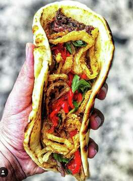 9of 9tacos using naan bread at peli peli kitchen a fast casual dining concept featuring the flavors of south africa from the owners of peli peli - Peli Peli Kitchen