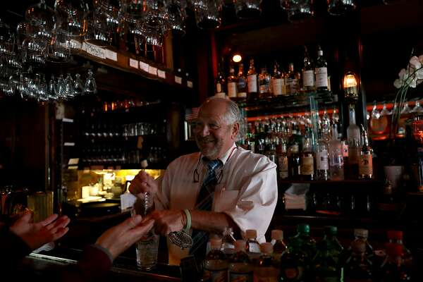 Michael Criscola, bartender and assistant manager, smiles merrily at a customer as he makes a martini at Brazen Head, located at 3166 Buchanan St., in San Francisco, Calif., on Saturday, August 18, 2018.