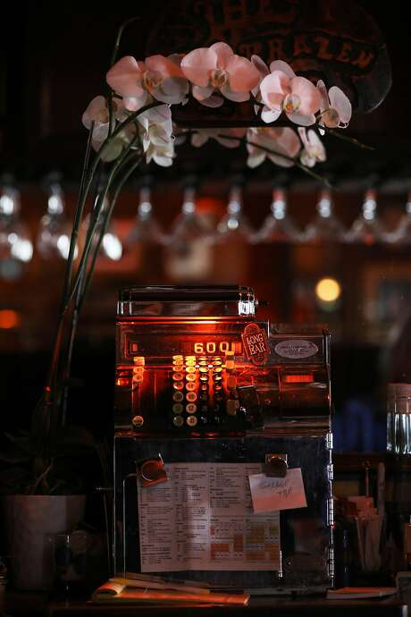 The Brazen Head's cash register is 80 years old. The bar recently began accepting credit cards. Photo: Yalonda M. James / The Chronicle