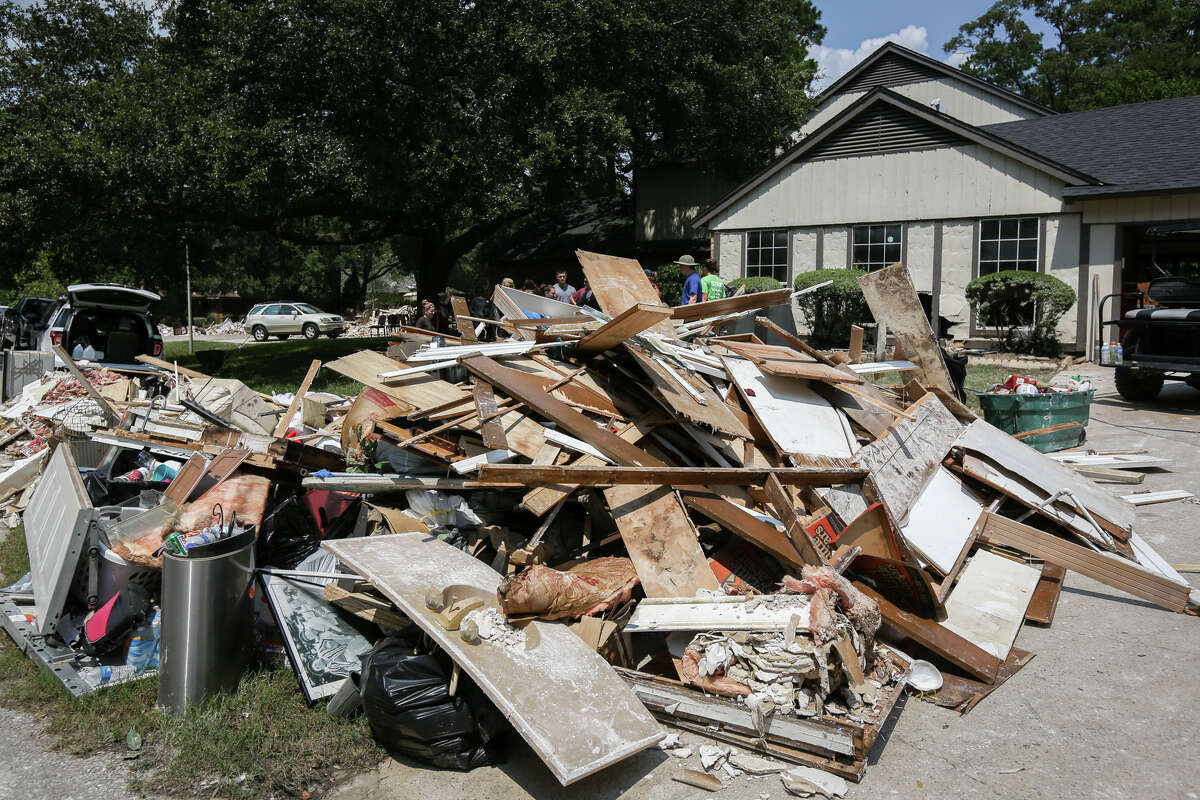 Piles of debris line the streets of the River Plantation community as homeowners and volunteers strip out unsalvageable furniture, drywall, carpet and more from homes flooded during Tropical Storm Harvey on Saturday, Sept. 2, 2017, in Conroe. CONTINUE to see photos from recent disasters in the Houston area.