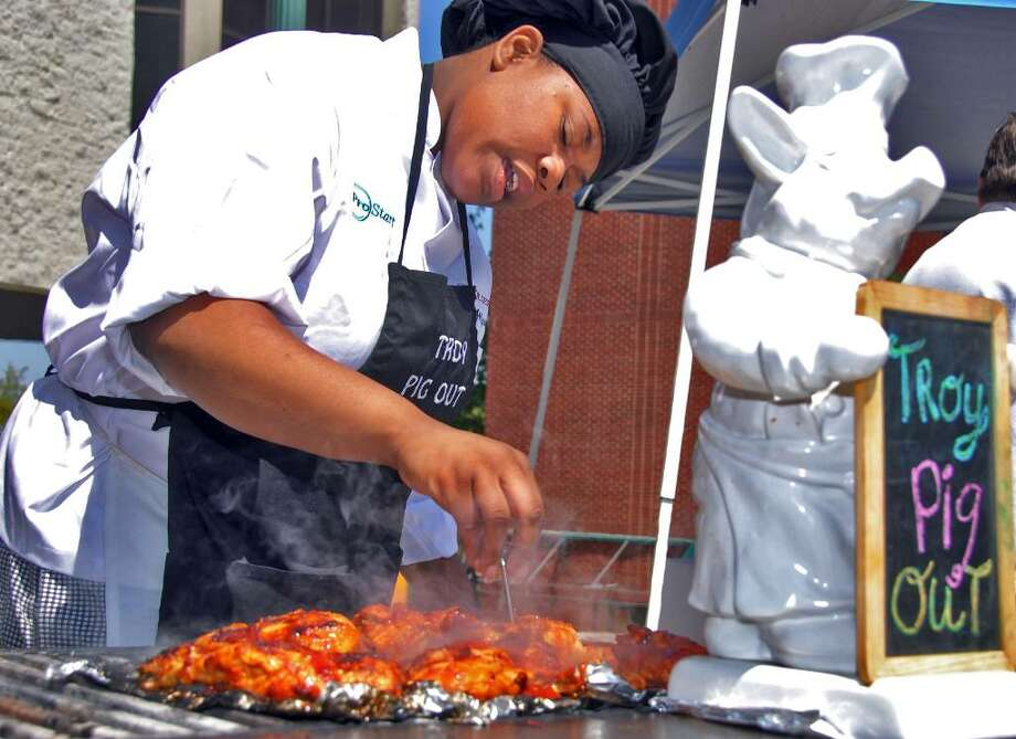 Allyson Cobbins checks a meat thermometer as she helps out at a barbecue demonstration at Troy City Hall in 2008 at the inaugural Troy Pig Out. (John Carl D'Annibale / Times Union) Photo: John Carl D'Annibale / Albany Times Union