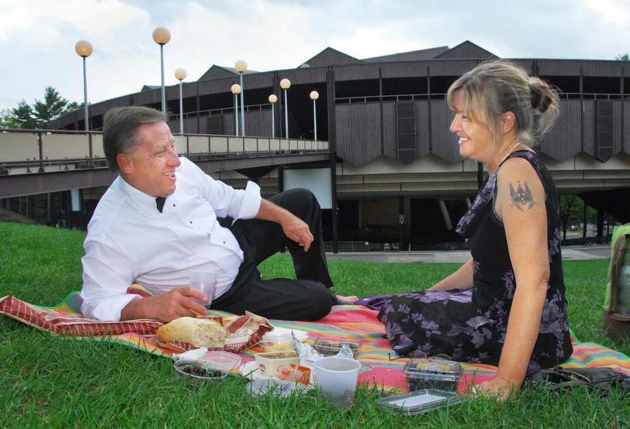 Harry Weinhagen and Annemarie Mitchell, both of Saratoga Springs, picnic on the SPAC lawn at the New York City Ballet Gala Saturday evening.   (John Carl D'Annibale / Times Union) Photo: John Carl D'Annibale / 00009429A
