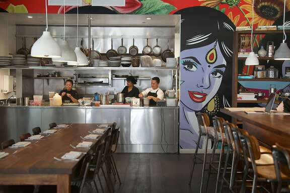 Viewof the kitchen  from part of the dining room of Besharam, a new Gujarati (West Indian) restaurant seen on Thursday, Aug. 16, 2018 in San Francisco, Calif.