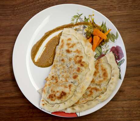 Kulchas, bread with butter chicken and peanut chutney, at Besharam in S.F. Photo: Liz Hafalia / The Chronicle