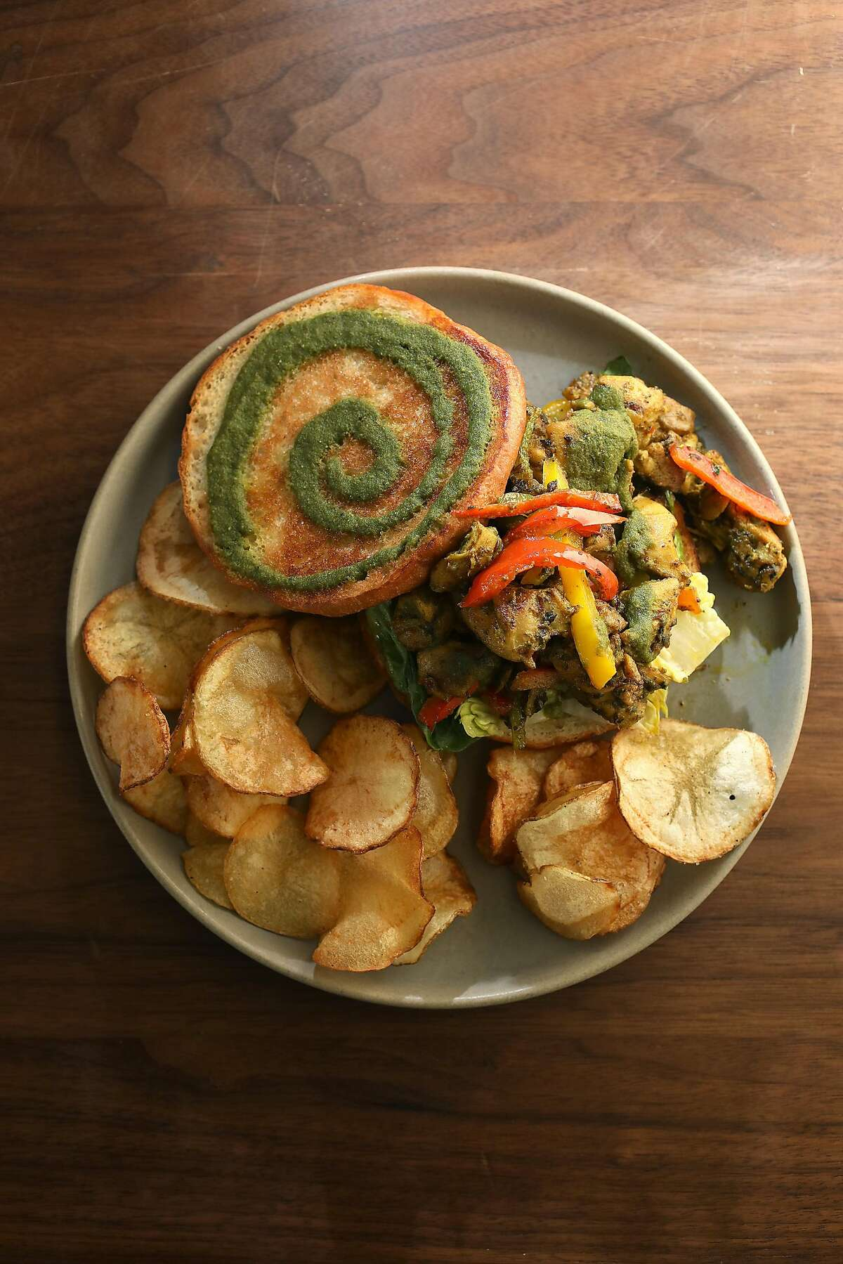 Chandni chawk chicken sandwich--cabbage slaw, mint and cilantro chutney--served at Besharam, a new Gujarati (west Indian) restaurant on Thursday, Aug. 16, 2018, in San Francisco, Calif.