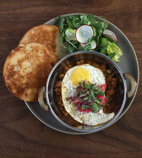 Pav bhaji, toasted buns, spiced vegetable curry, soft fried egg, at Besharam in S.F. Photo: Liz Hafalia / The Chronicle