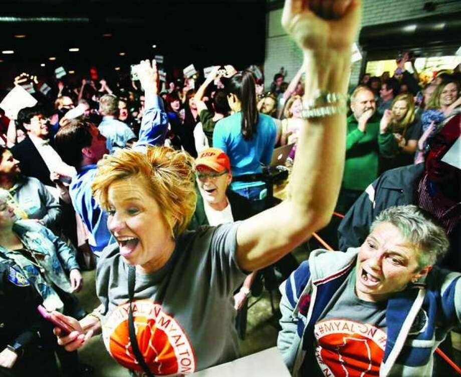A crowd reacts to the announcement of Alton being chosen to be the featured city on Small Business Revolution last year.