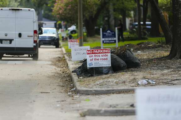 No parking signs line the streets in Nottingham Forest where homeowners compete for parking spaces with the contractors fixing homes, Thursday, July 26, 2018 in Houston. Many of the homes in the neighborhood are still unoccupied a year after floodwater inundated blocks of homes along the bayou. Houses in the neighborhood are in various states of rebuilding - some being remodeled, some completely demolished, some being raised and some simply sitting vacant.