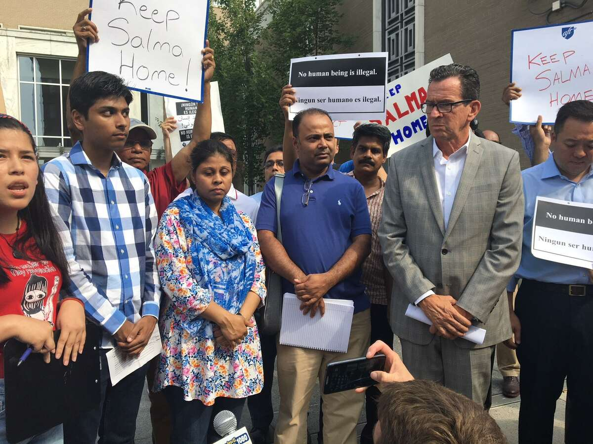 In this photo from July, from left, Samir Mahmud, his mother Salma Sikandar, his father Anwar Mahmud with Gov. Dannel P. Malloy protest planned deportation of Sikandar.