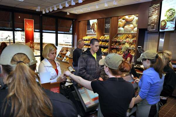 """Panera Bread is among the quick-service chains agreeing in August 2018 to end """"no-poach"""" policies under which neighboring franchisees agree not to hire away each other's workers, which critics say contribute to depressing wages. Staff Photographer Carol Kaliff."""