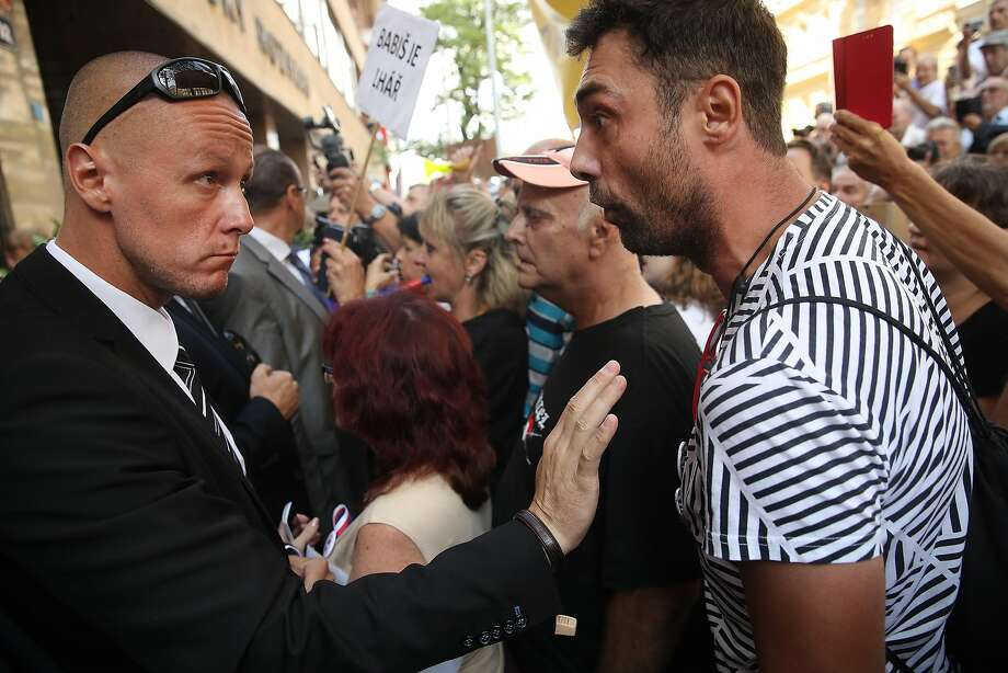 A security officer confronts a protester who had been shouting abuse at Premier Andrej Babis. Photo: Sean Gallup / Getty Images