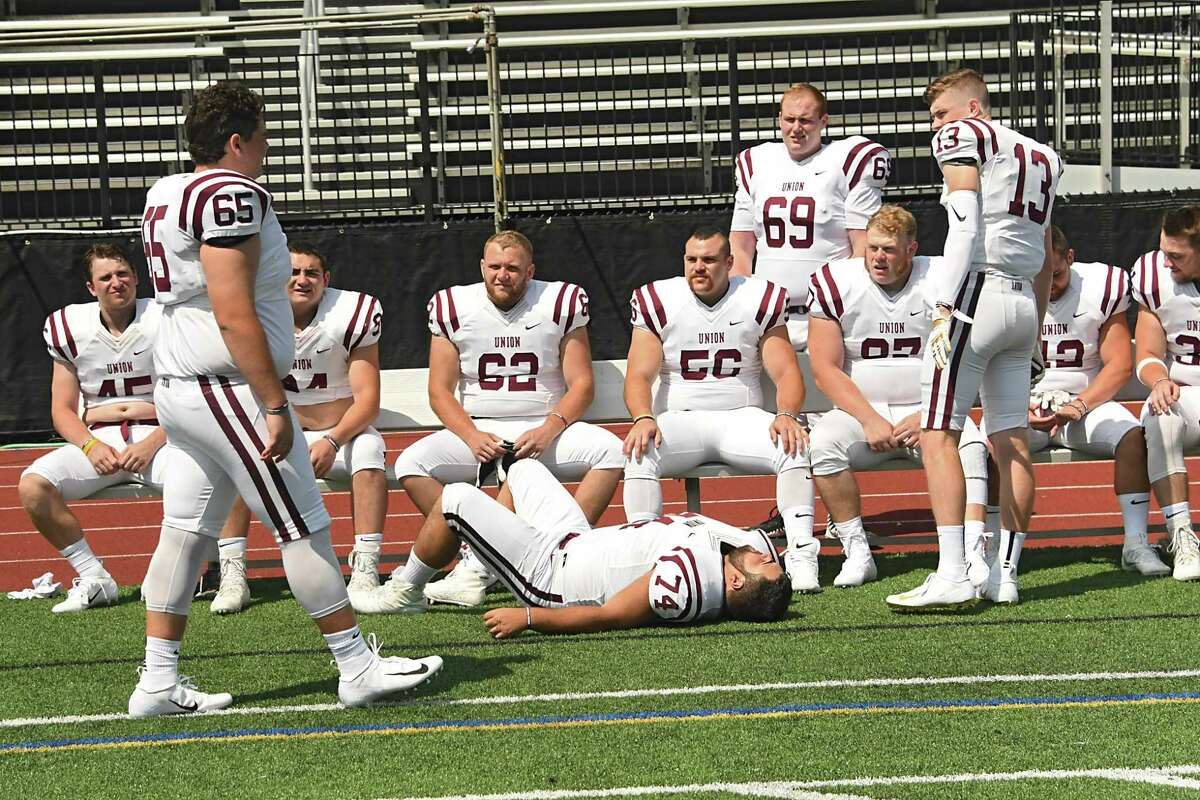 Players wait for the team photo to be taken after getting individual photos done as the Union College football team holds it's 2018 Media Day at Frank Bailey Field on Tuesday, Aug. 21, 2018 in Schenectady, N.Y. (Lori Van Buren/Times Union)