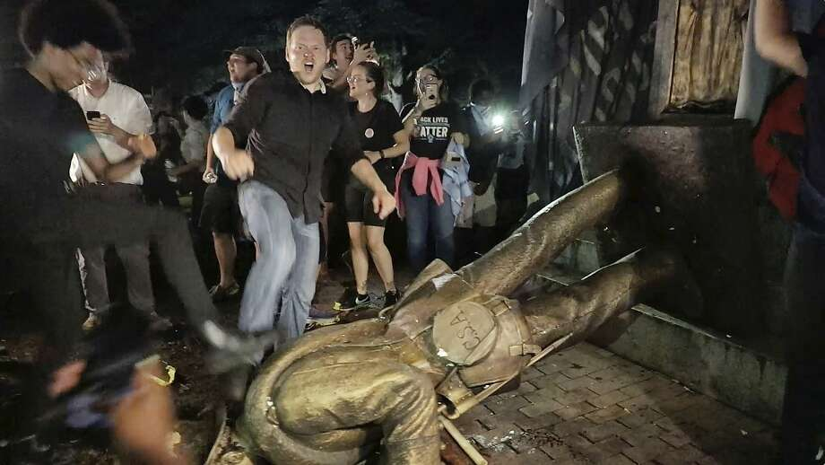 """Protesters celebrate after the Confederate statue known as """"Silent Sam"""" was toppled on the campus of the University of North Carolina in Chapel Hill, N.C., Monday, Aug. 20, 2018. (Julia Wall/The News & Observer via AP) Photo: Julia Wall, Associated Press"""