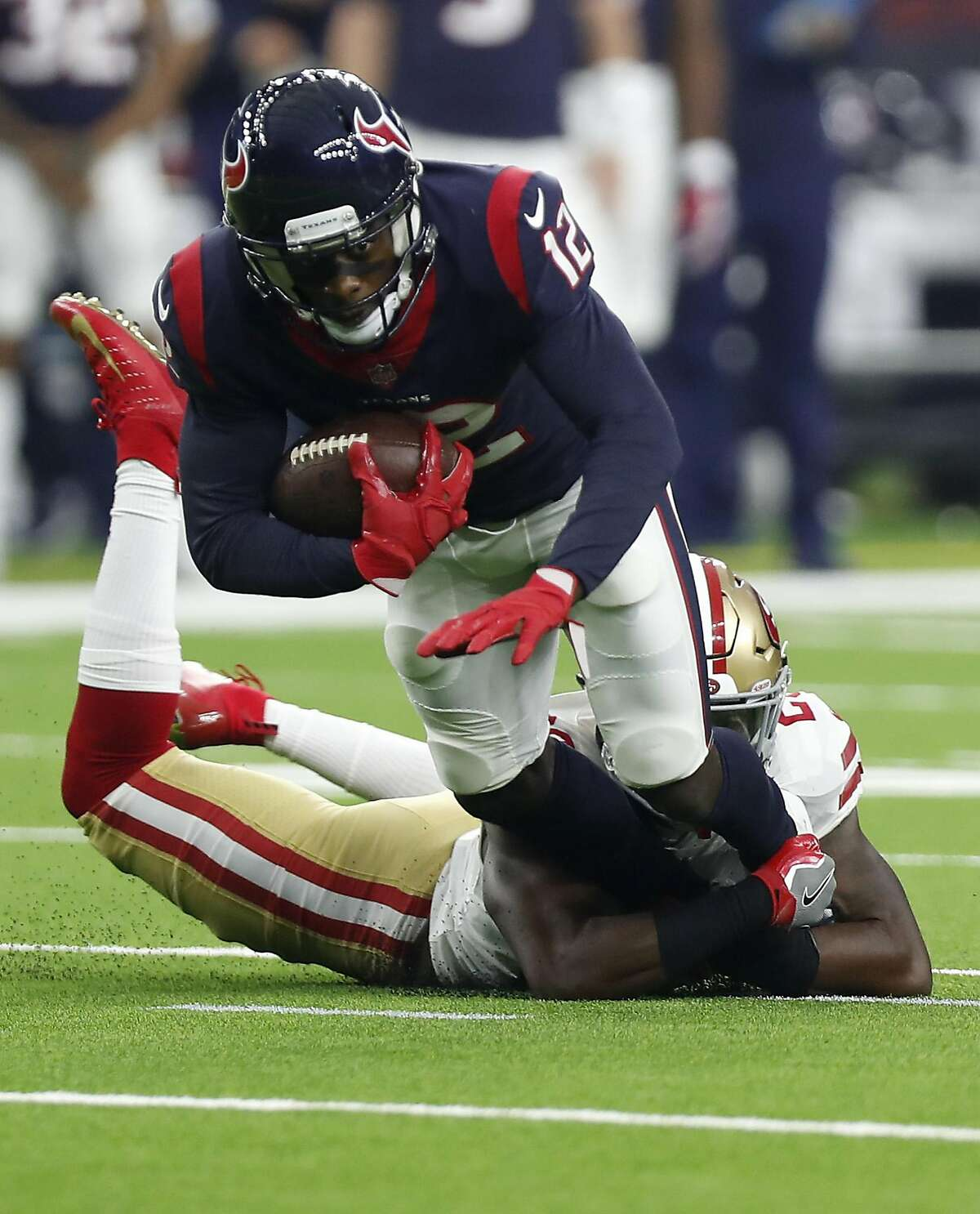 Houston Texans wide receiver Bruce Ellington (12) is stropped by San Francisco 49ers defensive back Jimmie Ward (20) during the first quarter of an NFL preseason football game at NRG Stadium on Saturday, Aug. 18, 2018, in Houston.