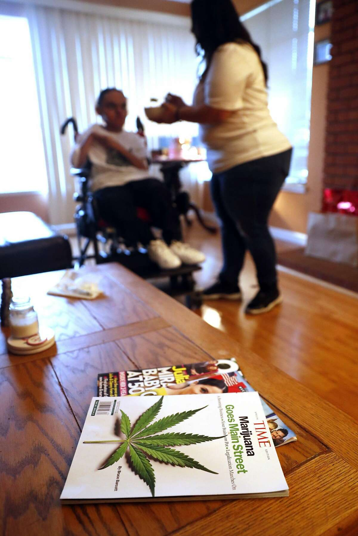 Karina Garcia feeds her son, JoJo, after administering medical marijuana to him at their home in San Bruno, Calif. on Monday, August 20, 2018.