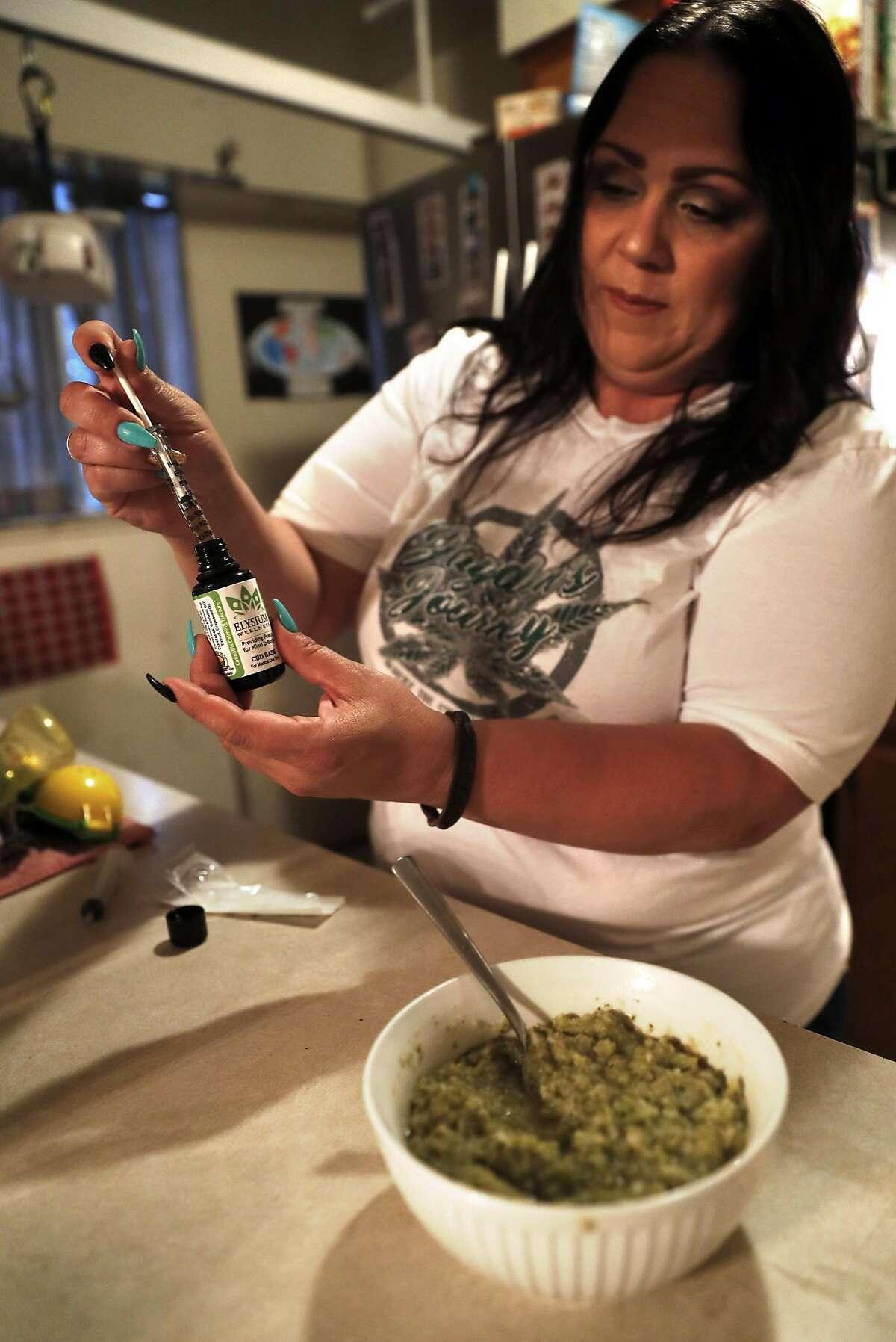 Karina Garcia prepares to administer medical marijuana to her son, JoJo, at their home in San Bruno, Calif. on Monday, August 20, 2018.