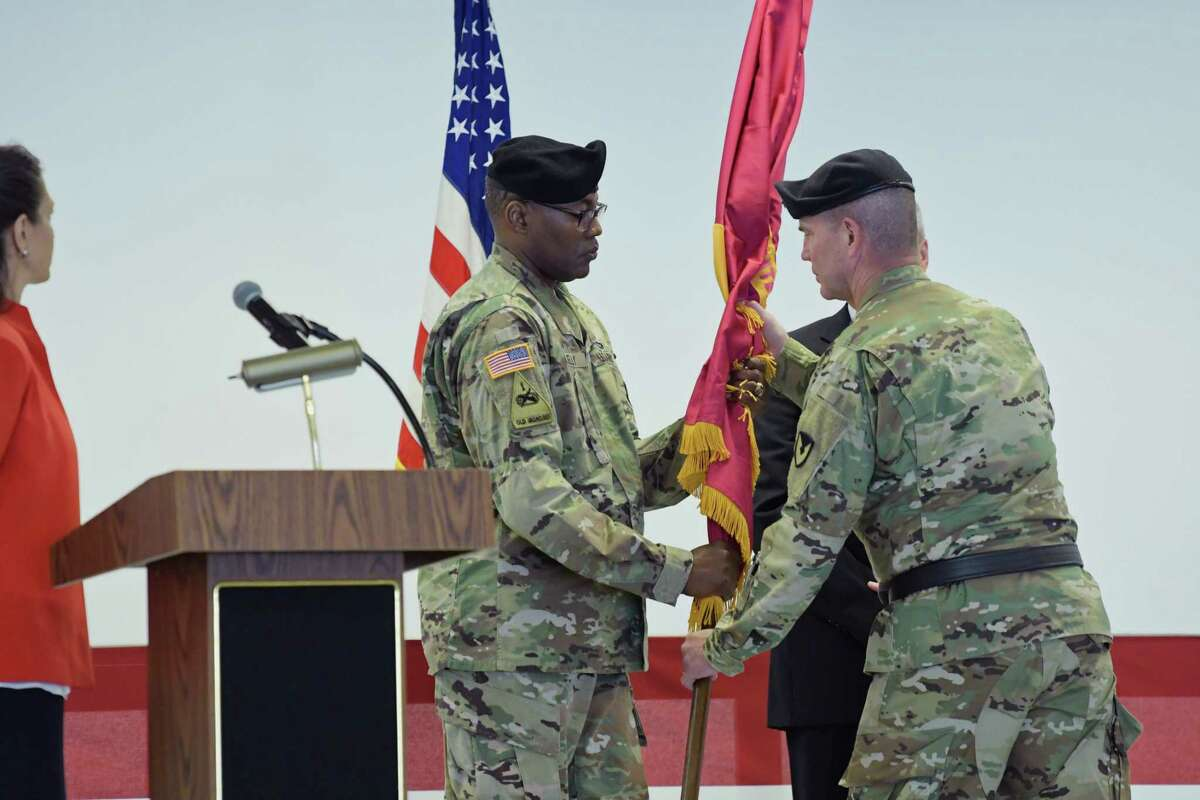 New Watervliet Arsenal commander, Colonel Milton Kelly, left, accepts the Unit Colors passed to him from Major General Daniel Mitchell, Commanding General of TACOM (U.S. Army Tank-automotive and Armaments Command) during a ceremony at the Watervliet Arsenal on Tuesday, Aug. 21, 2018, in Watervliet, N.Y. (Paul Buckowski/Times Union)