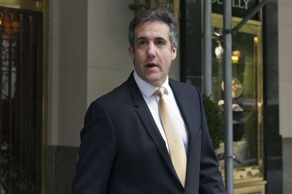 Michael Cohen, former personal lawyer to President Donald Trump, leaves his apartment building, in New York, Tuesday, Aug. 21, 2018. Cohen could be charged before the end of the month with bank fraud in his dealings with the taxi industry and with committing other financial crimes, multiple people familiar with the federal probe said Monday. (AP Photo/Richard Drew)