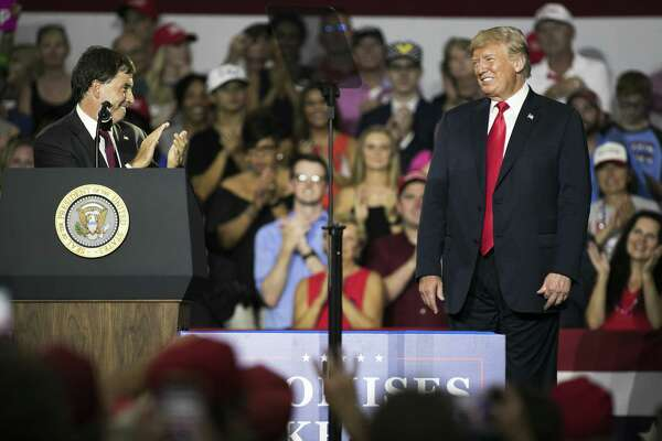 President Donald Trump, right, smiles as Ohio state Sen. Troy Balderson, a Republican congressional candidate, applauds him during a rally in Lewis Center, Ohio, on Aug. 4, 2018.