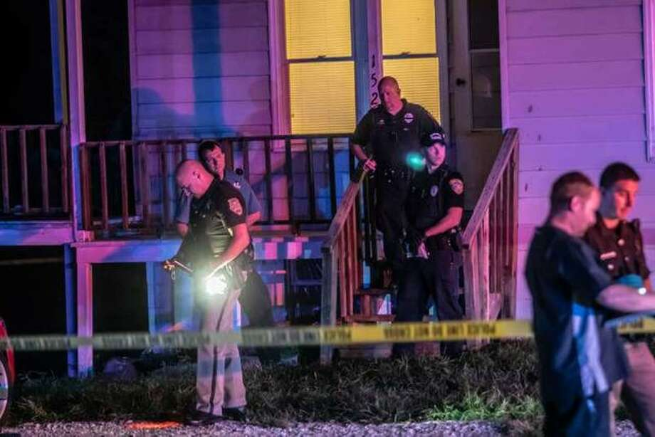 Police secure the scene outside of 152 S. Oak St. in Cottage Hills last week after a man there was shot and killed during a home invasion. Authorities filed charges in the case on Tuesday. Photo:     Nathan Woodside | Telegraph File Photo