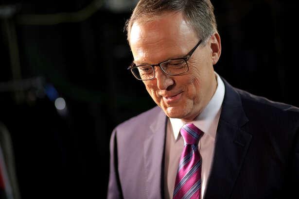 KTRK/13 chief meteorologist Tim Heller stands backstage of the newsroom set.