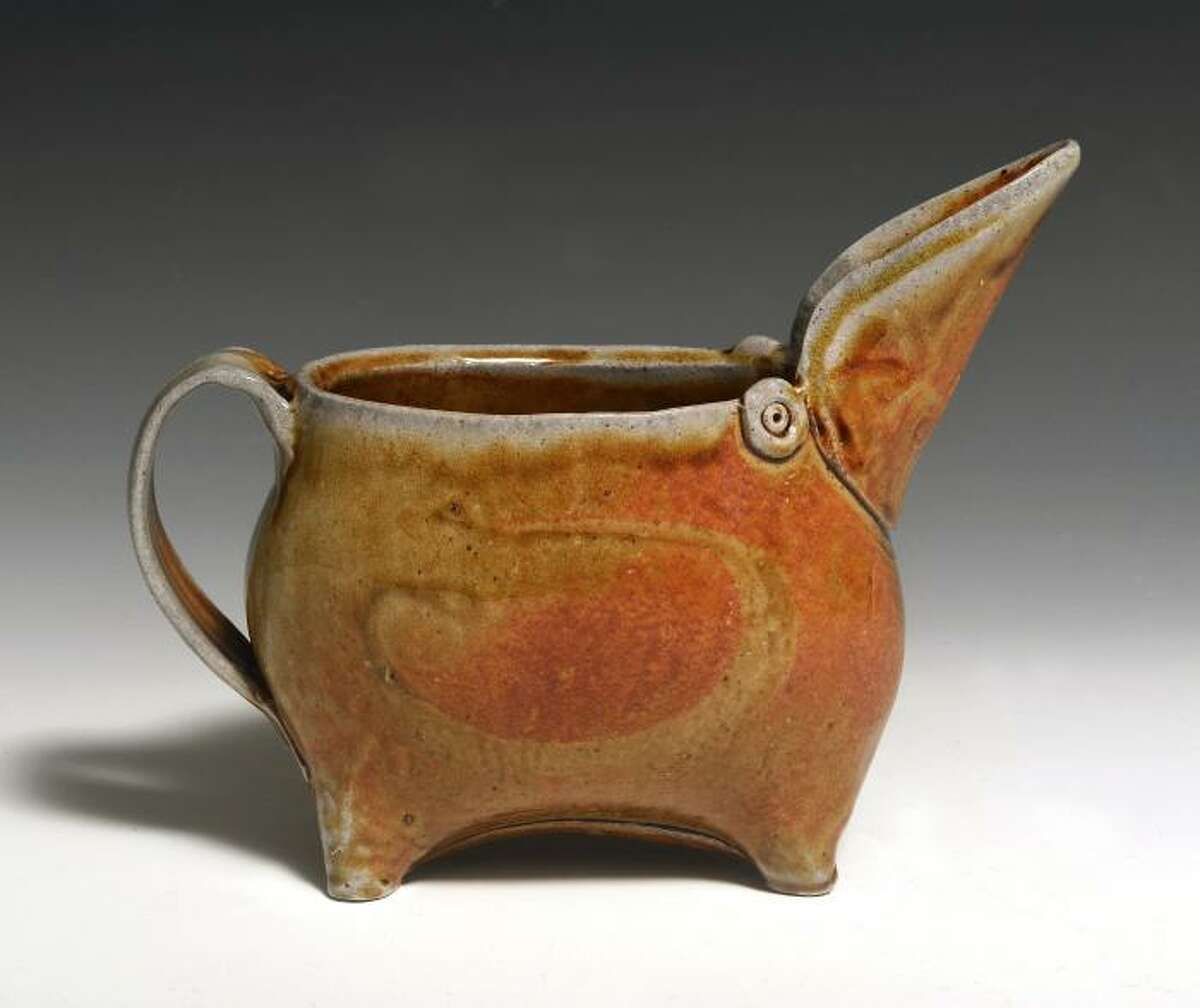 Alison Palmer's work often includes animal imagery, such as this bird pitcher. This Kent, Connecticut, artist has created ceramic works for more than 40 years. She searches to combine function with form with her handcrafted works.