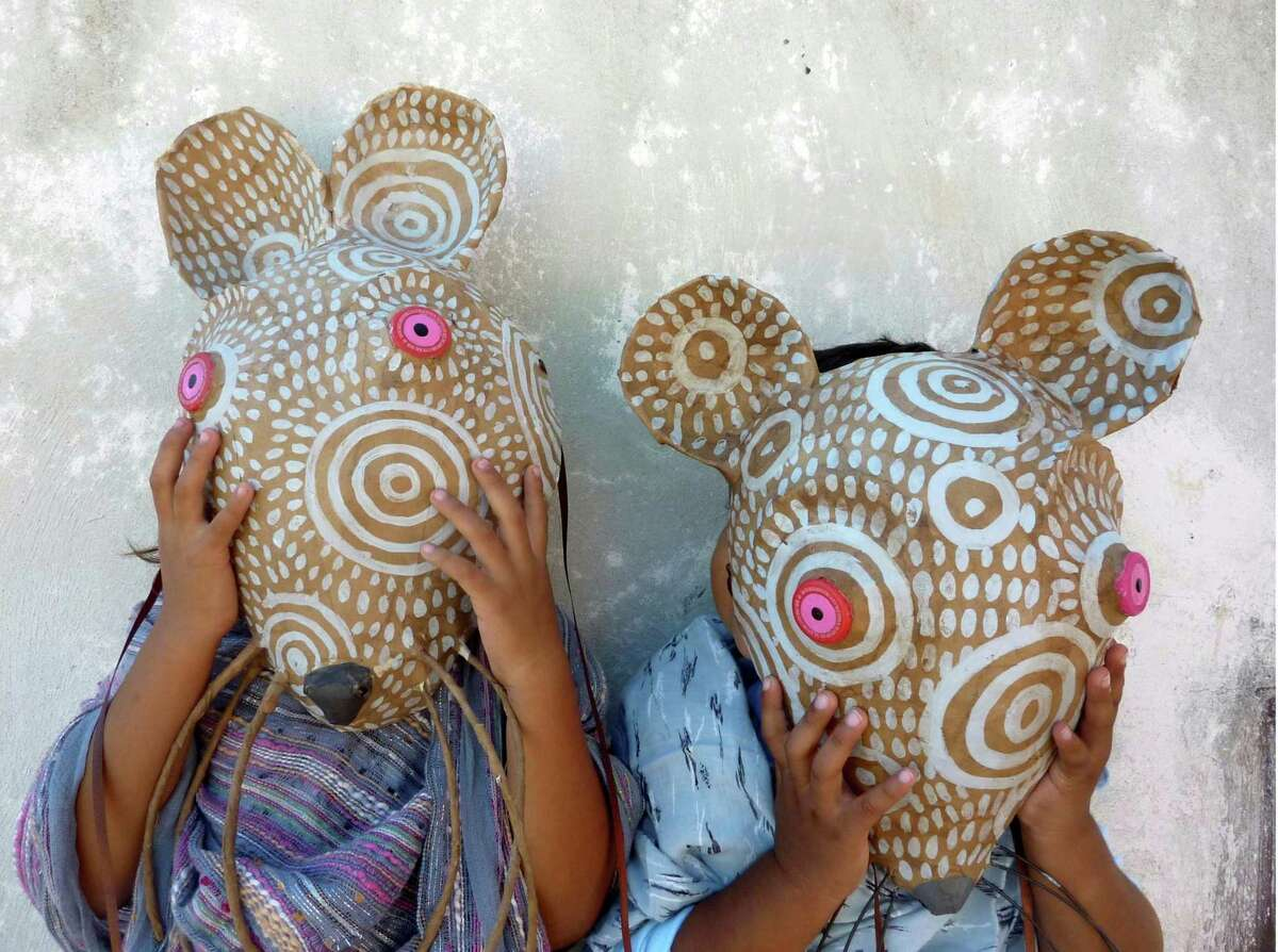 In addition to her pottery, Alison Palmer of Kent, Connecticut, creates papier-mache masks, which are inspired by found objects and her trips to Mexico. These are photographed in Merida, Mexico.