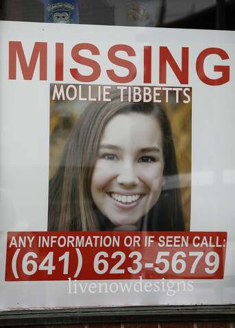 d34754a53c62 A poster for missing University of Iowa student Mollie Tibbetts hangs in  the window of a