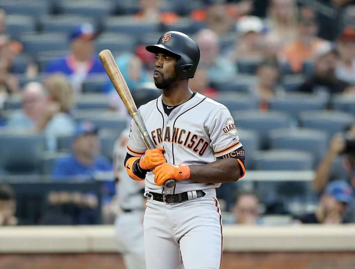 NEW YORK, NY - AUGUST 20: Andrew McCutchen #22 of the San Francisco Giants reacts after he struck out in the first inning against the New York Mets on August 20, 2018 at Citi Field in the Flushing neighborhood of the Queens borough of New York City. (Photo by Elsa/Getty Images)