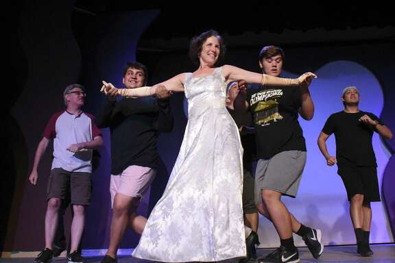 "Actress Anna Gangai and the rest of the cast of ""Hello, Dolly!"" rehearse the title number."