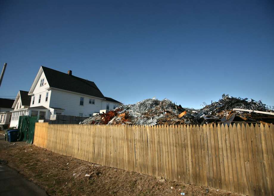 Mountains of scrap metal can be seen towering over a fence along Central Ave. in Bridgeport, Conn. in Februrary of 2012. Photo: Brian A. Pounds / File Photo / Connecticut Post