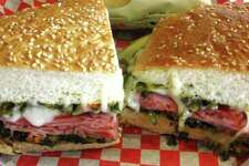The Hearthstone Lotta Muffaletta from Hearthstone Bakery Cafe is stacked with your choice of ham and salami or turkey, layered with diced olives and veggies, provolone cheese and toasted.