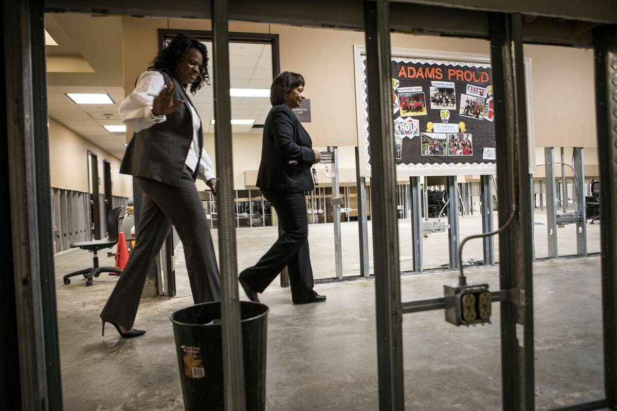 Adams Elementary School principal Cheryl Triplett and Dr. Kim Vine, chief academic officer for Port Arthur ISD, walk through the hallway of the flood-damaged school on Monday, Dec. 11, 2017, in Port Arthur, Texas.