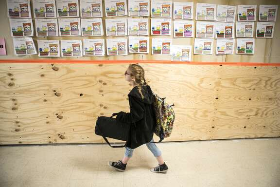 Plywood walls line the hallways at Orangefield ISD following flood damage from Hurricane Harvey on Monday, Dec. 11, 2017, in Orangefield, Texas.