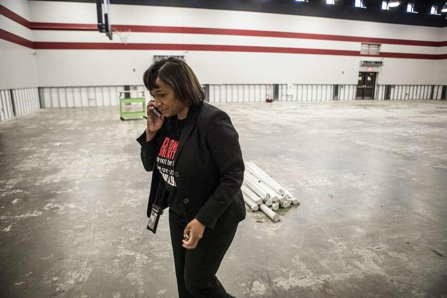 Adams Elementary School principal Cheryl Triplett takes a call as she walks through the gymnasium of her flood-damaged school on Monday, Dec. 11, 2017, in Port Arthur, Texas. Photo: Brett Coomer