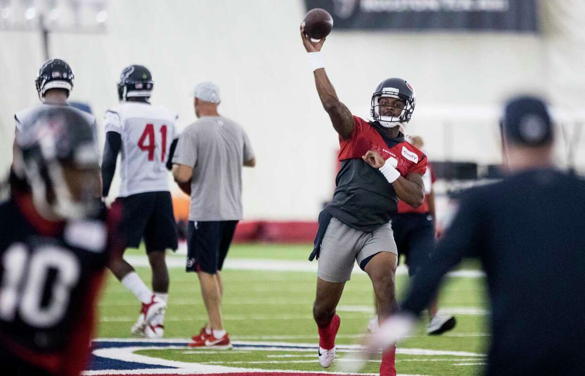 Houston Texans quarterback Deshaun Watson (4) throws a pass to wide receiver DeAndre Hopkins (10) during training camp at the Methodist Training Center on Tuesday, Aug. 21, 2018, in Houston.