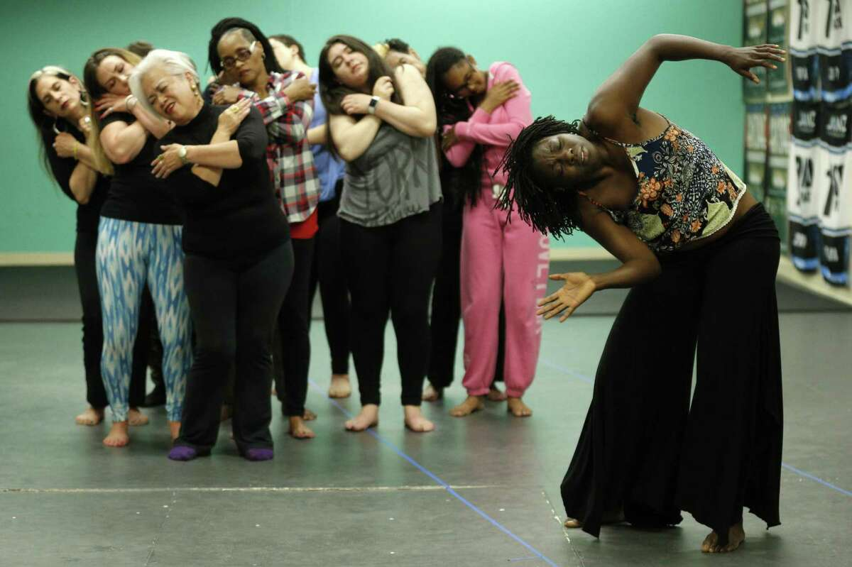 """Uzo Nwankpa (right) and the cast rehearse """"When Did Your Hands Become a Weapon?"""" at the African American Art & Culture Complex in S.F."""