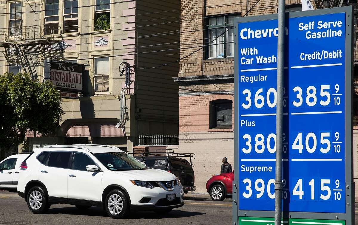 An SUV drives past a sign of gas prices at the Chevron station near 16th and South Van Ness streets in San Francisco, Calif. Saturday, Aug. 4, 2018.