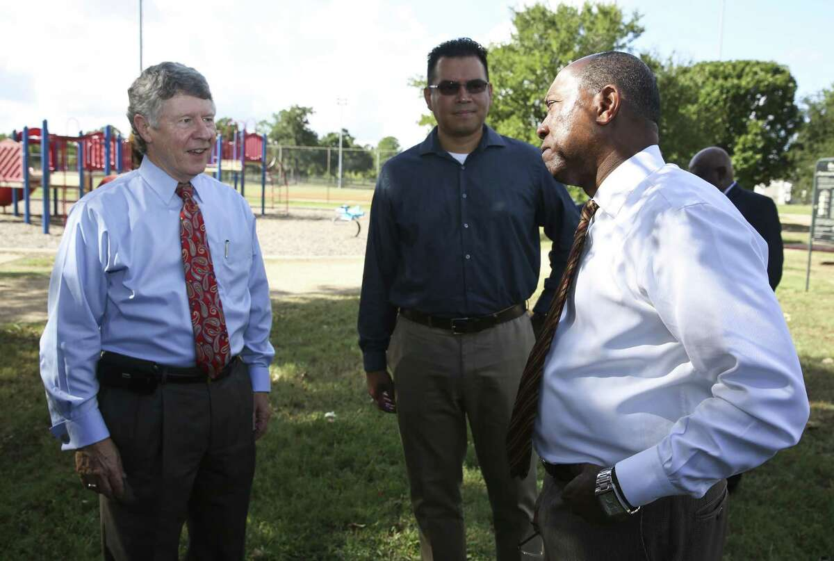 Harris County Judge Ed Emmett, from left, Harvey flood victim and pastor Oliver Lee, and Houston Mayor Sylvester Turner, chat before a news conference to rally for Saturday's $2.5 billion bond election for flood mitigation projects.